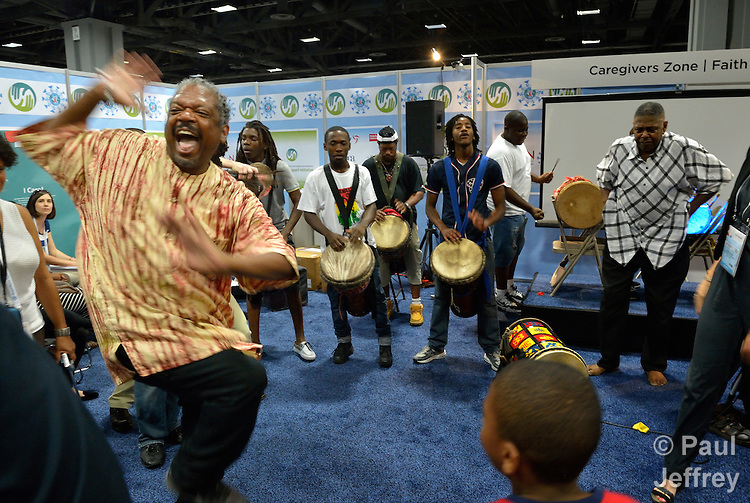 A man enjoys dancing during an informal gathering in the Faith Zone of the Global Village at the XIX International AIDS Conference in Washington, D.C.  The Faith Zone was sponsored by the Ecumenical Advocacy Alliance.