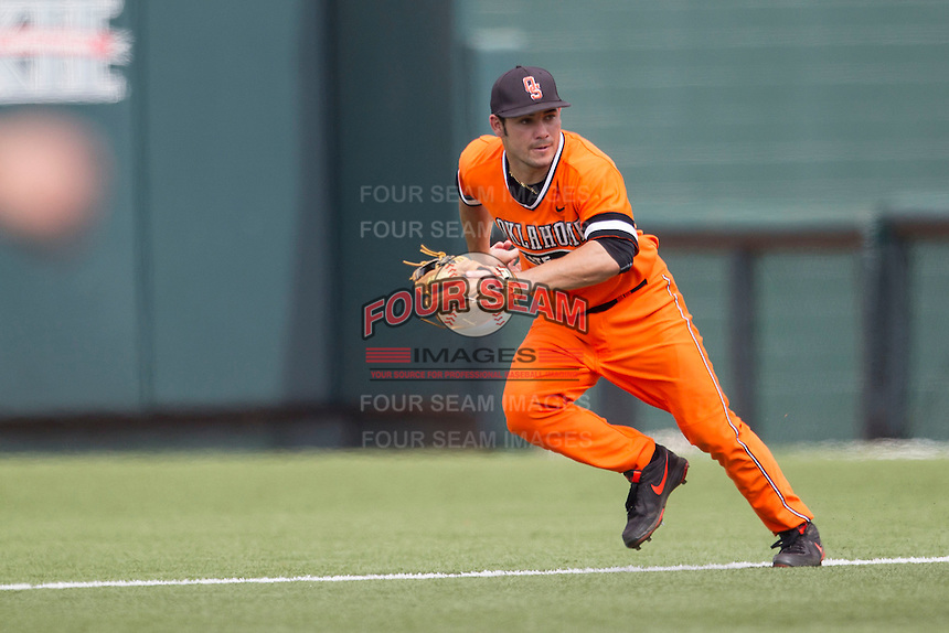 Oklahoma State Cowboys second baseman Tim Arakawa #2 tracks a ground ball during the NCAA baseball game against the Texas Longhorns on April 26, 2014 at UFCU Disch–Falk Field in Austin, Texas. The Cowboys defeated the Longhorns 2-1. (Andrew Woolley/Four Seam Images)
