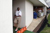 Virginia head coach Mike London watches the rain fall from the door to the locker room after lightning from a storm caused officials to evacuate the Scott Stadium during the first half of the Virginia/Brigham Young football game in Charlottesville, Va. Photo/Andrew Shurtleff