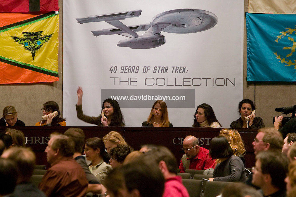6 October 2006 - New York City, NY - Christie's employees take bid over the phone during the auction sale of items from the television show Strar Trek at Christie's auction house in New YOrk City, USA, 6 October 2006.