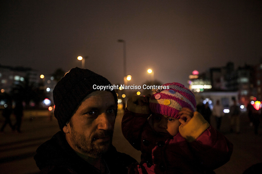 February 17, 2016: A family of migrants from Herat, Afghanistan gather at the metro staiton in Aksaray, a neighbourhood located in the Fatih district of Istanbul. The area has turned into one of the main destinations along the smuggling route for the refugees and migrants on their way to Europe.