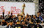 Shabab Hebron players celebrate with the trophy after winning the final match of the Palestinian Cup (Abu Ammar Cup), in the West Bank city of Hebron, on October 15, 2016. Photo by Wisam Hashlamoun