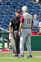 Florida State Seminoles head coach Mike Martin #11 argues a call with umpire Lou Acello during a scrimmage against the Philadelphia Phillies at Brighthouse Field on February 29, 2012 in Clearwater, Florida.  Philadelphia defeated Florida State 6-1.  (Mike Janes/Four Seam Images)