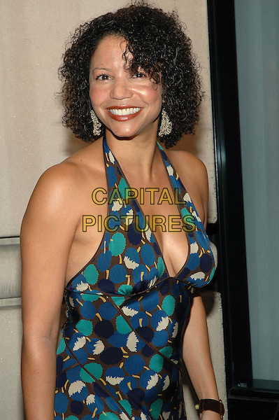 GLORIA REUBEN.Gala opening of SELF Magazine's SELF Center Day Spa on Fifth Avenue in Manhattan, New York, New York..The spa will offer discounted spa services, proceeds from which will got to benefit Breast Cancer Awareness Month. .September 26th, 2005.Photo Credit: Patti Ouderkirk/AdMedia/Capital Pictures.Ref: PO/ADM/CAP.half length halterneck cleavage blue green pattern print.www.capitalpictures.com.sales@capitalpictures.com.© Capital Pictures.