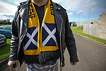 A home supporter with a scarf featuring a Scottish saltireflag, making his way from Shielfield Park, after the Scottish League Two fixture between Berwick Rangers and East Stirlingshire. The home club occupied a unique position in Scottish football as they are based in Berwick-upon-Tweed, which lies a few miles inside England. Berwick won the match by 5-0, watched by a crowd of 509.