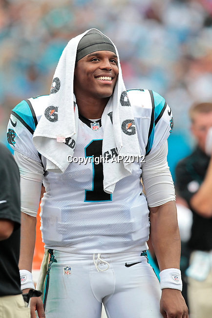 Carolina Panthers quarterback Cam Newton (1) watches the action from the sidelines during an NFL game against the New Orleans Saints September 16, 2012 in Charlotte, N.C. (AP Photo/Margaret Bowles)