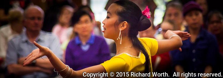 A dancer from the China Dance School of San Francisco performs during a Lunar New Year Celebration at a neighborhood library