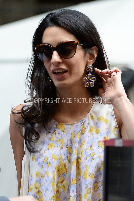 WWW.ACEPIXS.COM<br /> April 18, 2015 New York City<br /> <br /> Amal Clooney on the film set of 'Money Monster' in the Financial District of Manhattan on April 18, 2015 in New York City. <br /> <br /> By Line: Kristin Callahan/ACE Pictures<br /> ACE Pictures, Inc.<br /> tel: 646 769 0430<br /> Email: info@acepixs.com<br /> www.acepixs.com