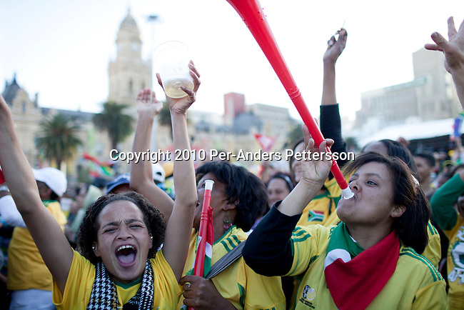 CAPE TOWN, SOUTH AFRICA - JUNE 22: Female soccer fans reacts to a game between South Africa and France shown on giant monitors on June 22, 2010, in central Cape Town, South Africa. Thousands of fans came to support the host nation South Africa in the 2010 World Cup soccer in South Africa. South Africa beat France 2-1 but both teams were eliminated in the group stage. In hosting the largest sporting event in the world, South Africa has a chance to impress the world with their beautiful and friendly country, hoping that it moth long event will bring long lasting benefits for the country. (Photo by Per-Anders Pettersson/Getty Images)