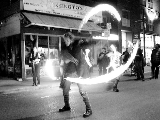 Halloween in Kensington Market, Toronto's historic market district, provides stimulating entertainment from acrobats, jugglers, musicians and other artists