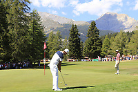 Ashun Wu (CHN) putts on the 5th green during Sunday's Final Round 4 of the 2018 Omega European Masters, held at the Golf Club Crans-Sur-Sierre, Crans Montana, Switzerland. 9th September 2018.<br /> Picture: Eoin Clarke | Golffile<br /> <br /> <br /> All photos usage must carry mandatory copyright credit (© Golffile | Eoin Clarke)