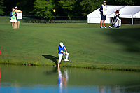 David Lingmerth (SWE) chips on to 12 with one foot in the lake during round 1 of the Shell Houston Open, Golf Club of Houston, Houston, Texas, USA. 3/30/2017.<br /> Picture: Golffile | Ken Murray<br /> <br /> <br /> All photo usage must carry mandatory copyright credit (&copy; Golffile | Ken Murray)