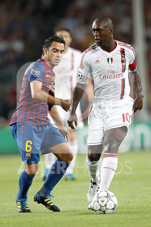 Barcelona's Xavi Hernandez and AC Milan's Clarence Seedorf  during Champions League match on september 13th 2011...Photo: Cesar Cebolla / ALFAQUI