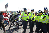 Carnival against the Arms Trade. Brighton, England. The protest was called against arms manufacturer EDO MBM which is based just outside of Brighton. After meeing at the Level In Brighton the protest moved up to EDO MBM where scuffles broke out between protesters and the Police. The demonstrators forced their way into the car park of EDO MBM where some windows were broken. There were ten arrests.