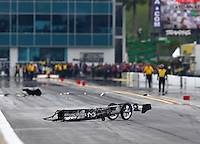 Mar 14, 2015; Gainesville, FL, USA; The front half of the dragster of NHRA top fuel driver Larry Dixon sits on the track after his car broke in half and crashed during qualifying for the Gatornationals at Auto Plus Raceway at Gainesville. Dixon walked away from the incident. Mandatory Credit: Mark J. Rebilas-USA TODAY Sports