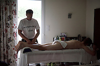 soigneur Joachim Schoonacker (BEL) massages Luke Durbridge (AUS/Orica-GreenEDGE)<br /> <br /> 2015 Tour de France<br /> Orica-GreenEDGE restday 2 in Gap
