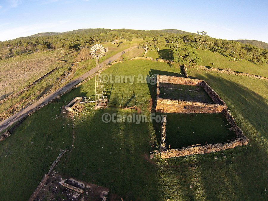 Low-level aerials from a quadcopter of the ruins, stone walls and windmill at Telegraph City, Calaveras Co., Calif. during spring.