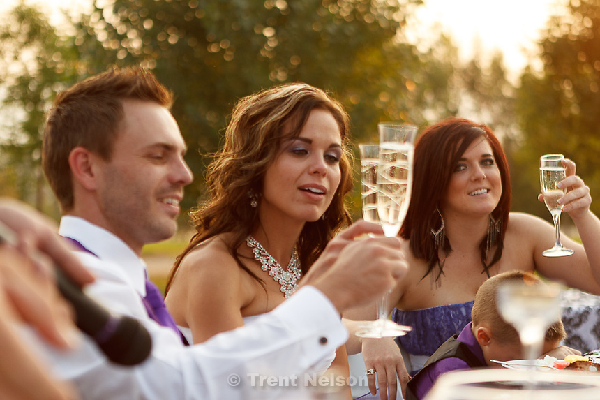 Trent Nelson  |  The Salt Lake Tribune.Jen Comer (formerly Jen Carver, center), shares a toast with her husband Daniel Comer and Maid of Honor Janae Davis at their wedding reception in Hunstville, Utah Saturday, August 18, 2012.