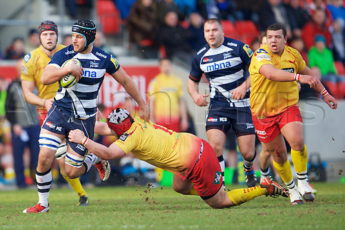 07.02.2015.  Sale, England.  LV Cup Rugby. Sale Sharks versus Scarlets. Sale Sharks number 8 Mark Easter out runs Llanelli Scarlets Prop Rhys Thomas.