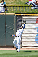 Round Rock Express LF Esteban German (6) makes a catch against the Iowa Cubs on April 10th, 2011 at Dell Diamond in Round Rock, Texas.  (Photo by Andrew Woolley / Four Seam Images)