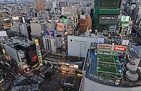 Playing tennis on a roof in the center of Tokyo, Shibuya District. Tokyo is the most populated metropolitan area with 35 million people.<br /> <br /> Richard Jones  /  Sinopix