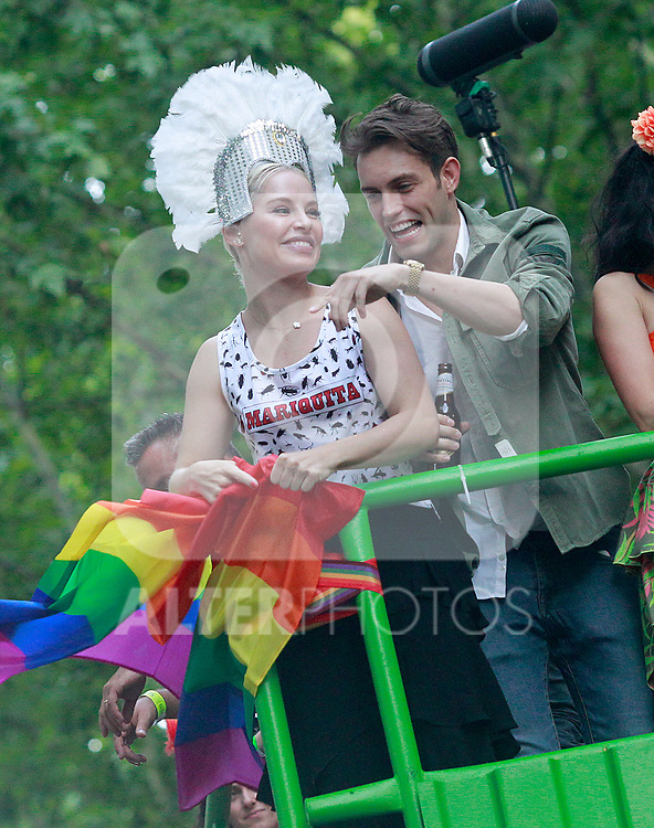 Spanish singer Soraya (l) with her boyfriend Miguel Herrera during the demonstration of World Pride Madrid 2017. July 1, 2017. (ALTERPHOTOS/Acero)