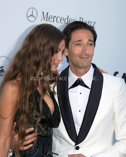 WWW.ACEPIXS.COM....US Sales Only....May 23 2013, New York City....Adrien Brody with Lara Lieto at amfAR's Cinema Against AIDS Gala at the Hotel du Cap Eden Roc during the Cannes Film Festival on May 23 2013 in France....By Line: Famous/ACE Pictures......ACE Pictures, Inc...tel: 646 769 0430..Email: info@acepixs.com..www.acepixs.com