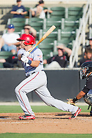Spencer Kieboom (20) of the Hagerstown Suns follows through on his swing against the Kannapolis Intimidators at CMC-Northeast Stadium on May 31, 2014 in Kannapolis, North Carolina.  The Intimidators defeated the Suns 3-2 in game one of a double-header.  (Brian Westerholt/Four Seam Images)