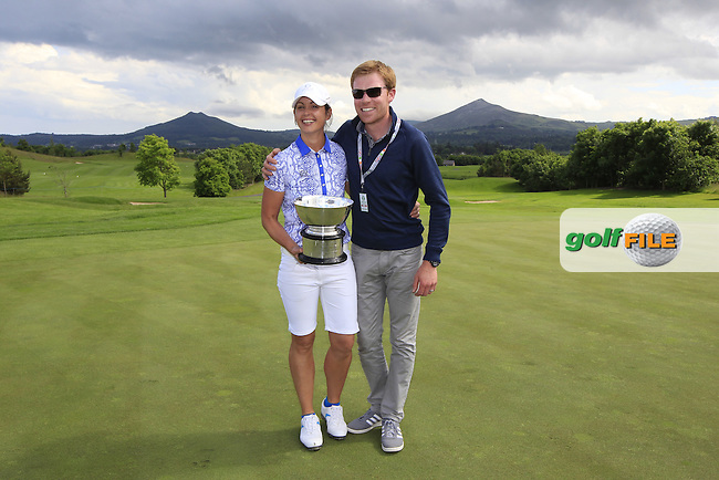 Maria Dunne and Her husband with the Curtis Cup after the Sunday Singles matches at the 2016 Curtis cup from Dun Laoghaire Golf Club, Ballyman Rd, Enniskerry, Co. Wicklow, Ireland. 12/06/2016.<br /> Picture Fran Caffrey / Golffile.ie<br /> <br /> All photo usage must carry mandatory copyright credit (&copy; Golffile | Fran Caffrey)