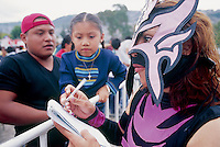 Amapola signs Autographs before one of the wrestling matches. Ecatepec, Estado de Mexico, Mexico 2004