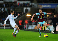 Swansea City's Tom Carroll battles with Burnley's Charlie Taylor<br /> <br /> Photographer Ashley Crowden/CameraSport<br /> <br /> The Premier League - Swansea City v Burnley - Saturday 10th February 2018 - Liberty Stadium - Swansea<br /> <br /> World Copyright &copy; 2018 CameraSport. All rights reserved. 43 Linden Ave. Countesthorpe. Leicester. England. LE8 5PG - Tel: +44 (0) 116 277 4147 - admin@camerasport.com - www.camerasport.com
