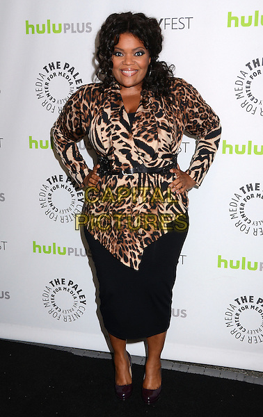 Yvette Nicole Brown.The Paley Center For Media's PaleyFest 2013 Honoring 'Community' at Saban Theatre, Los Angeles, California, USA.  .March 5th, 2013.full length black skirt brown leopard print top belt hands on hips.CAP/ADM/BT.©Birdie Thompson/AdMedia/Capital Pictures.