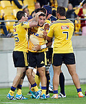 Hurricanes team members congratulate halfback TJ Perenara, centre, after scoring a try against the ACT Brumbies in the Super Rugby match at Westpac Stadium, Wellington, New Zealand, Friday, March 07, 2014. Credit: Dean Pemberton