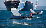 Day 3 of the Sail Sydney 2009 regatta, Moth class..Held annually Sail Sydney take place from the 5-8 December 2009 on the magnificent Sydney Harbour as part of the Sail Down Under series, incorporating Sail Brisbane, Sail Sydney and Sail Melbourne..Competitors from around the world bring Sydney Harbour to life as athletes look to establish themselves on the sailing scene in the lead up to the London Olympics in 2012..The four day regatta incorporate Olympic, International and Youth classes on the three Sydney Harbour courses used by the 2000 Sydney Olympics. Spectacular action from the 49er and International Moth classes can be expected along with the Laser, Laser Radial, Finn, RS:X and 470s as they campaign towards 2012..Over 400 participate and sail out of host venue: Woollahra Sailing Club in Rose Bay.