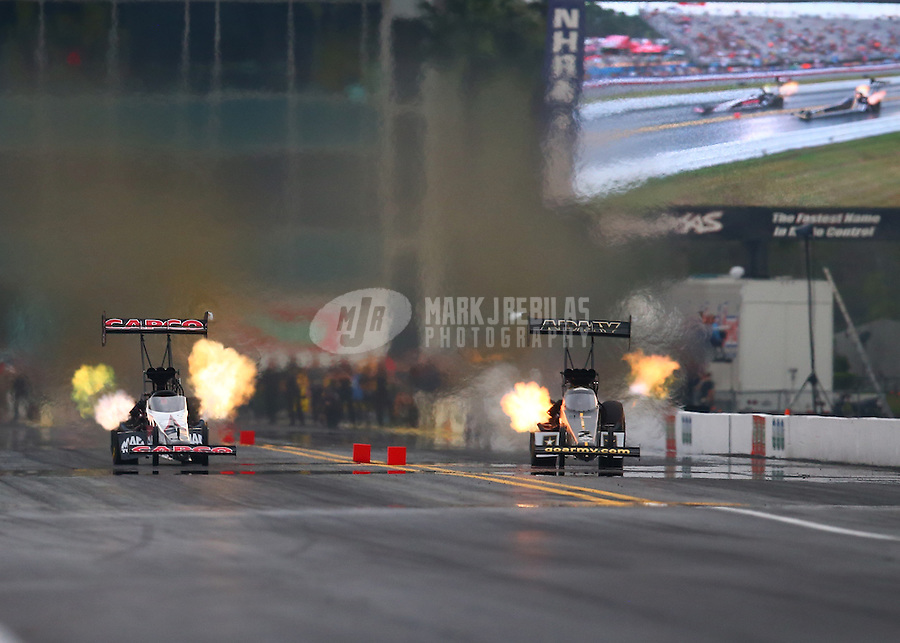 Mar 18, 2016; Gainesville, FL, USA; NHRA top fuel driver Steve Torrence (left) races alongside Tony Schumacher during qualifying for the Gatornationals at Auto Plus Raceway at Gainesville. Mandatory Credit: Mark J. Rebilas-USA TODAY Sports