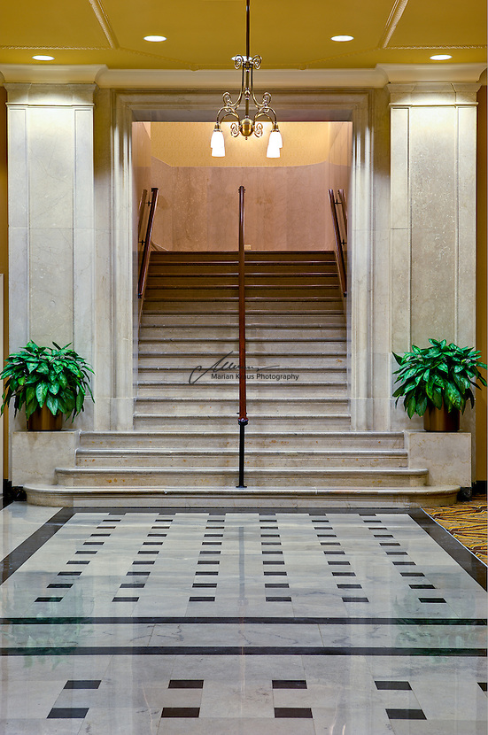 The marvelous staircase at the Doubletree Hotel Fort Shelby in downtown Detroit. In 1917 a group of investors sought to build an affordable hotel near Fort Street Union Station. They hired Schmidt, Garden & Martin of Chicago to design the building and the 10-story 450 room hotel opened in 1917. The hotel was so successful that in 1926 they broke ground for what was to be the first of two 450 room expansions, the 27 story Albert Kahn designed addition opened in 1927. However, the Great Depression halted plans for building of the second addition...In 1951 it was sold to the Albert Pick Hotels chain and renamed the Pick-Fort Shelby. With more business opting for newer suburban hotels and motels the Pick-Fort Shelby struggled with low occupancy throughout the late 1960s and early 1970s. Pick closed the hotel in 1973 and sold the building to three twenty something investors who reopened it as The Shelby Hotel, a hotel/apartment complex geared toward youth in 1974, however, this was short-lived and it soon closed again. For many years, the Anchor Bar, a popular watering hole for workers at the nearby Detroit News and Detroit Free Press remained the only tenant until moving in 1994. RSC & Associates, a real estate investment and development firm, started work on this hotel in the spring of 2007, and finished construction in December 2008