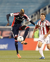 New England Revolution forward Saer Sene (39) controls the ball. In a Major League Soccer (MLS) match, the New England Revolution tied Chivas USA, 3-3, at Gillette Stadium on August 29, 2012.