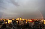 A rainbow appears above buildings following a rainstorm in Gaza city on February 10, 2019. Photo by Mahmoud Ajjour