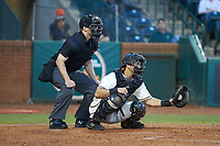 Greensboro Grasshoppers catcher Zac Susi (45) frames a pitch as home plate umpire Tanner Moore looks on during the game against the Hagerstown Suns at First National Bank Field on April 6, 2019 in Greensboro, North Carolina. The Suns defeated the Grasshoppers 6-5. (Brian Westerholt/Four Seam Images)