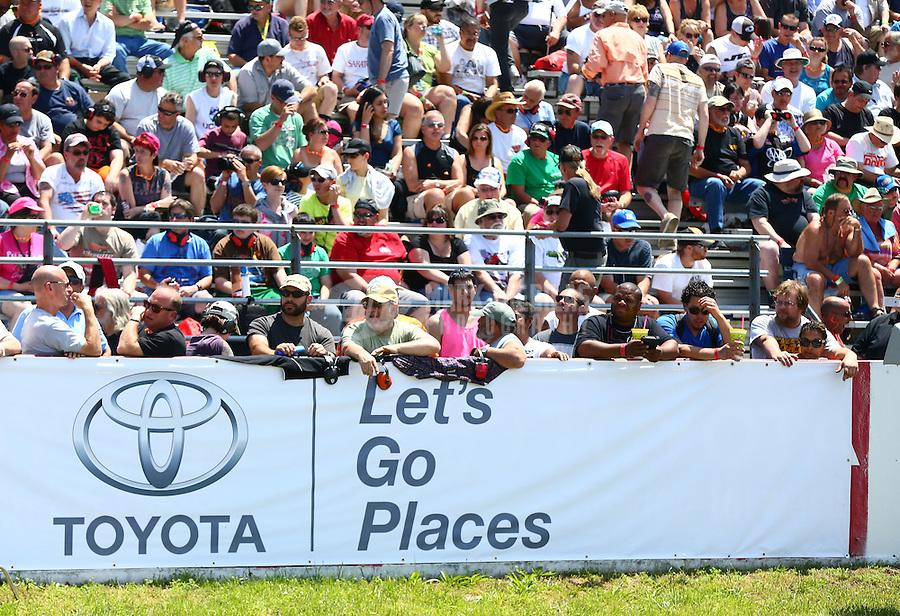 June 1, 2014; Englishtown, NJ, USA; NHRA fans in the grandstands during the Summernationals at Raceway Park. Mandatory Credit: Mark J. Rebilas-