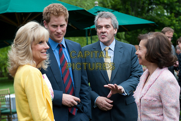 Prince Harry (L) and Sir Peter Westmacott (2nd-L), the British Ambassador to the United States, talk to Dr. Jill Biden (R), the wife of U.S. Vice President Joe Biden, during a reception for U.S. and British wounded warriors at the British Ambassador's Residence in Washington, D.C.,  USA..May 7th, 2012.royal royalty half length blue suit red tie.CAP/ADM/CNP/KD.©Kevin Dietsch/CNP/AdMedia/Capital Pictures...CAP/ADM/CNP/KD.©Kevin Dietsch/CNP/AdMedia/Capital Pictures