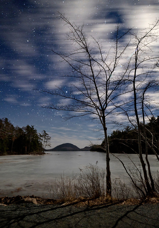 Stars and moonlight over Eagle Lake during winter on Mount Desert Island at Acadia National Park, Maine