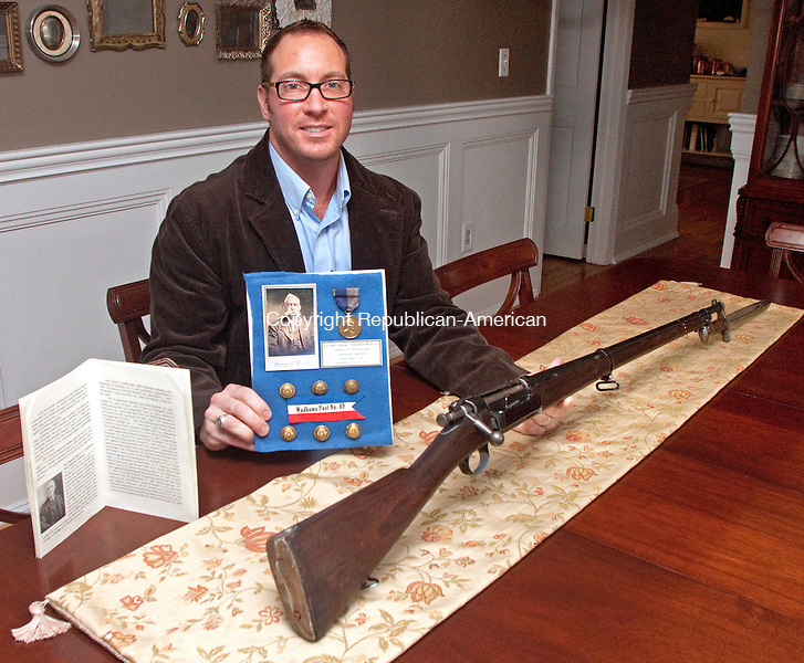 WATERBURY CT- APRIL 08 2015 040815DA02- Peter J. Hopson of Middlebury holds a bayonette and rifle from 1898 olong with other memorabilia of an era of when his great-great grandfathers met when one rescued the other from a Confederate prison camp.<br /> Darlene Douty Republican American