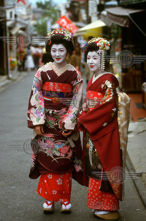 Two young women dressed as Maikos, Geishas in training.