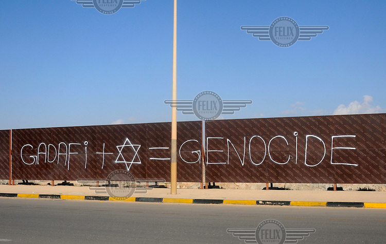 Graffiti on a wall reading 'Gadafi + Star of David = Genocide.' On 17 February 2011 Libya saw the beginnings of a revolution against the 41 year regime of Col Muammar Gaddafi.