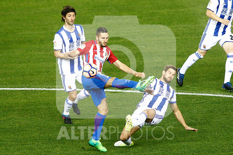 Atletico de Madrid's Koke Resurrecccion (c) and Real Sociedad's Esteban Granero (l) and Inigo Martinez during La Liga match. April 4,2017. (ALTERPHOTOS/Acero)