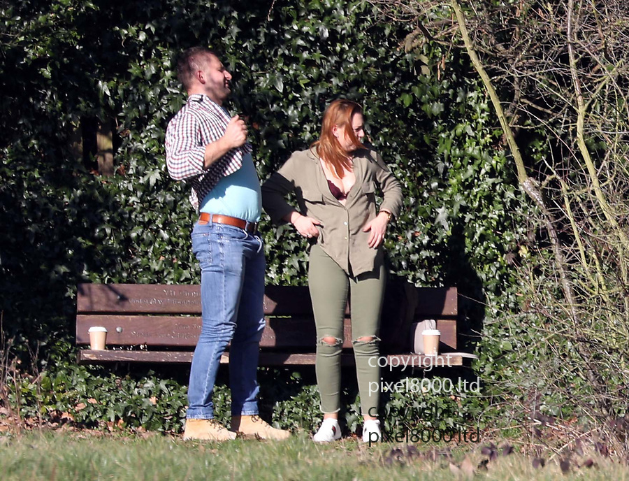 Pic shows: Hot weather Hampstead Heath<br /> hottest February on record  25.2.19<br /> <br /> This couple were getting very steamed up in full view of walkers enjoying the sun.<br /> <br /> The chap was getting more and more carried away. At first contenting himself with a bum squeeze but soon he couldn't keep his hand out of the shirt.<br /> <br /> At one point he seemed to bury his head in her chest.<br /> <br /> When they stood up they needed to readjust their clothing somewhat.<br /> <br /> <br /> <br /> pic by Gavin Rodgers/Pixel8000