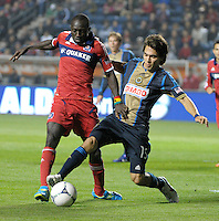 Philadelphia Union midfielder Gabriel Farfan (15) slide tackles the ball away from Chicago Fire forward Dominic Oduro (8).  The Chicago Fire defeated the Philadelphia Union 1-0 at Toyota Park in Bridgeview, IL on March 24, 2012.