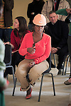 """JOHANNESBURG, SOUTH AFRICA AUGUST 10: Oprah Winfrey inspects school uniforms being modeled at the site of her school """"Oprah Winfrey Leadership Academy for Girls"""" located about 40 miles south of Johannesburg in Henley-on-Klip, Meyerton. Oprah visited South Africa to interview girls and to inspect the construction of the school. .(Photo by Per-Anders Pettersson)..."""