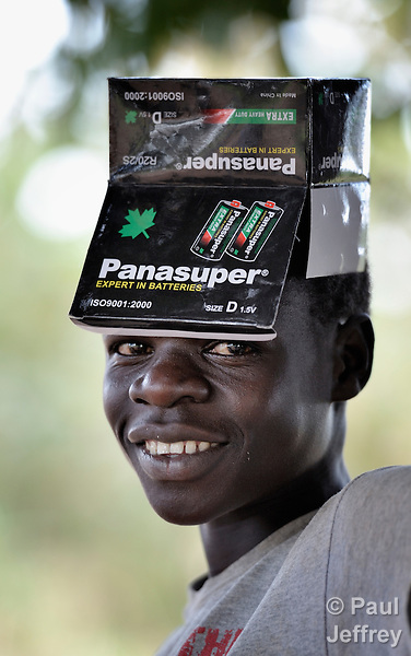 A boy uses a battery box as a hat in the Southern Sudan village of Pisak. NOTE: In July 2011 Southern Sudan became the independent country of South Sudan.